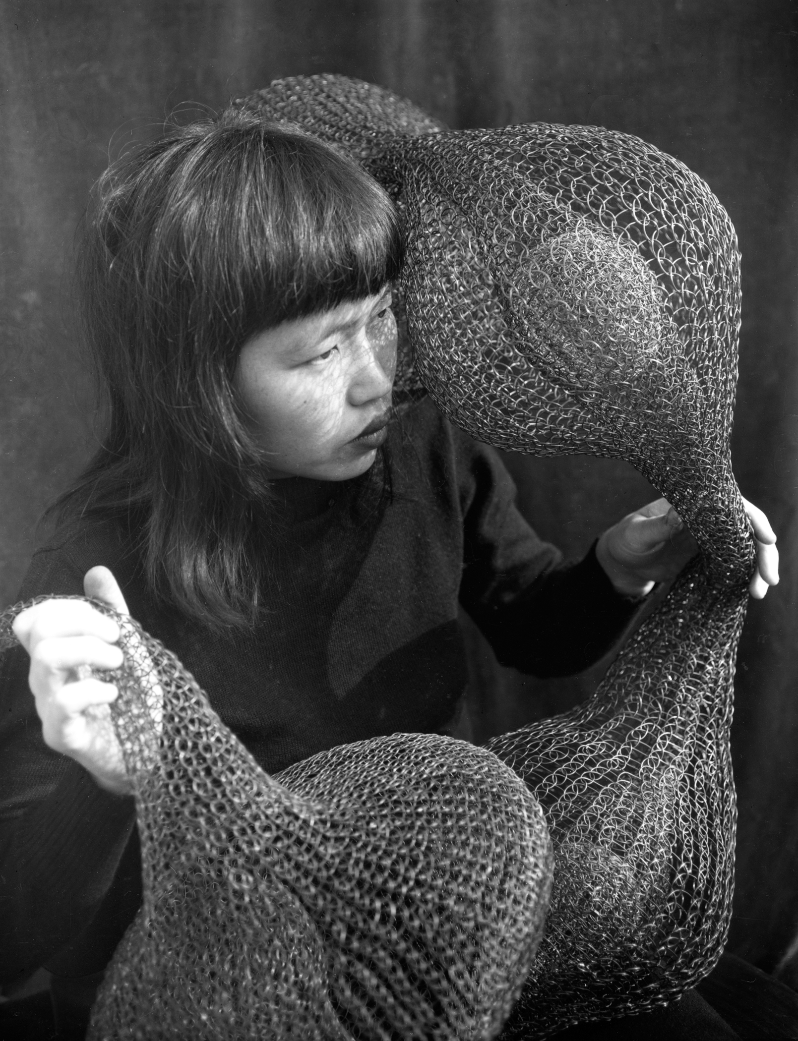 ruth_asawa_holding_a_form-within-form_sculpture_5x7