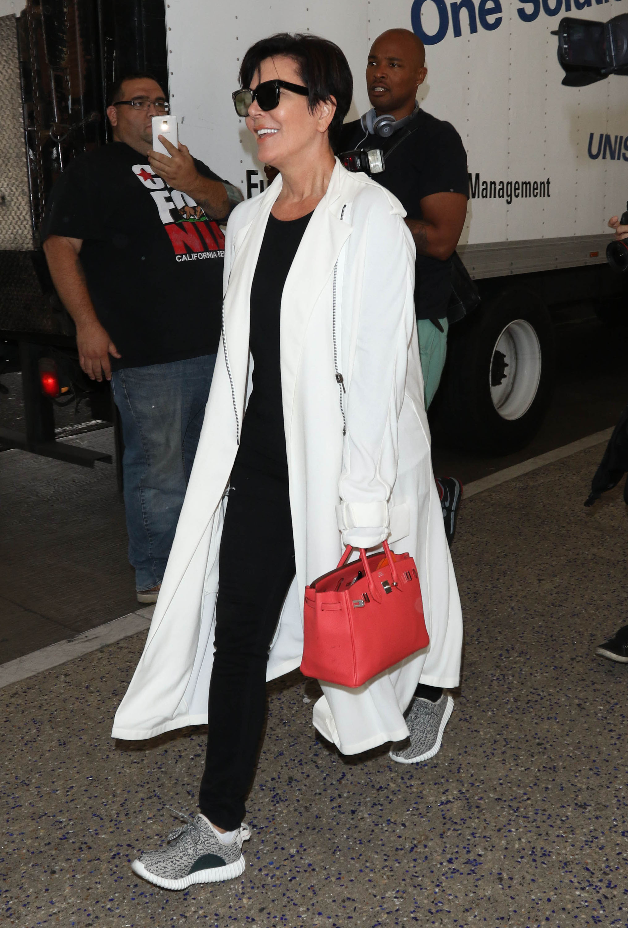 Kris & Kendall Jenner Touch Down At LAX