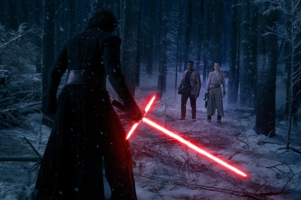 Star Wars: The Force Awakens L to R: Kylo Ren (Adam Driver), Finn (John Boyega), and Rey (Daisy Ridley) Ph: David James © 2015 Lucasfilm Ltd. & TM. All Right Reserved.